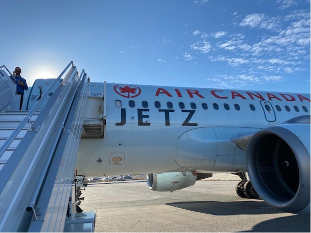 boarding the Air Canada Jetz aircraft